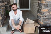 Man sitting on steps staring into camera